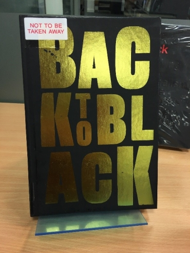 front cover of book, black with title in large shiny gold writing